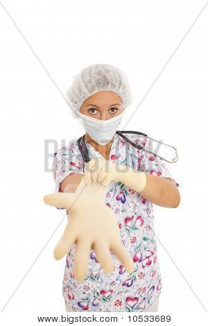 Portrait of young nurse putting on rubber gloves