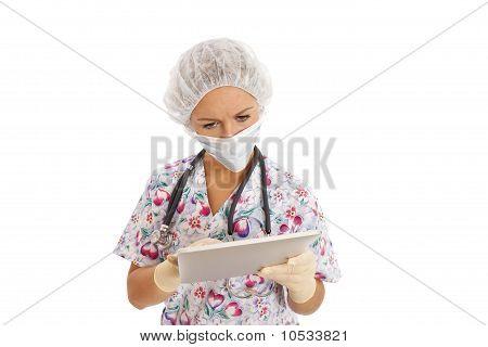 Portrait of young nurse using a touch screen computer