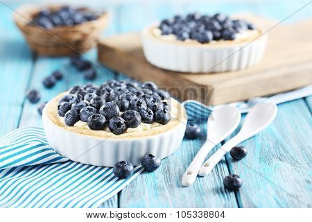 Homemade Blueberry Tart On Blue Wooden Table