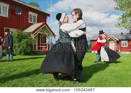 eople wearing historical costumes perform traditional dance in Roli, Norway.