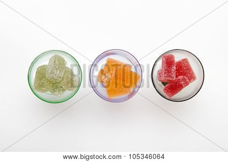 Colors Marmalade In Wineglass On White  Backgrounds
