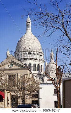 Montmartre narrow street overlooking a Basilica of Sacre-Coeur Paris France