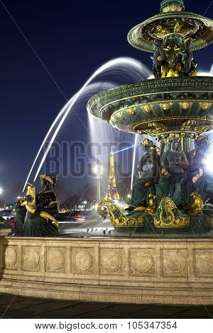 PARIS FRANCE MARCH 15 2012: Fountain in Place de la Concorde at night on March 14 2012 in Paris Fran