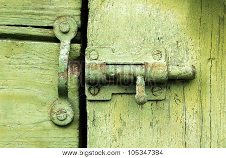 Old Latch On Green Wooden Door.