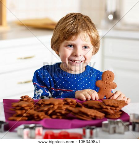 Boy Baking Christmas Cookies At Home