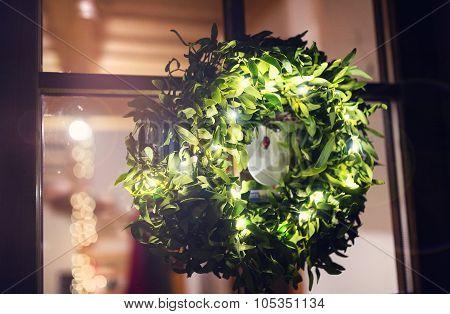 Green mistletoe wreath