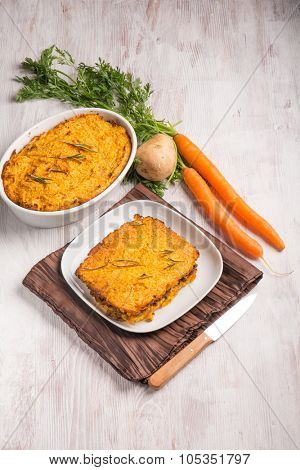 cake with potatoes carrots and minced meat