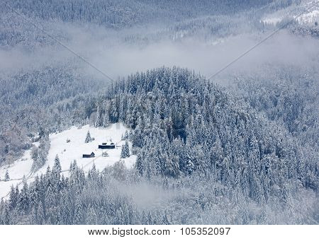 Small house in winter mountains
