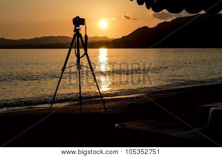 Silhouette Of A Camera And Tripod At Sunset On The Island Of Rhodes