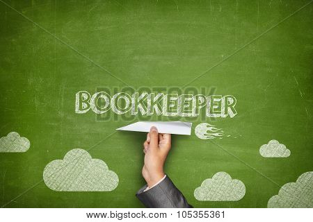 Bookkeeper concept on blackboard with paper plane