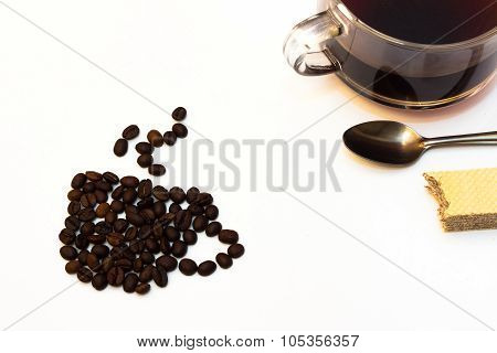 cup of black coffee with roasted beans