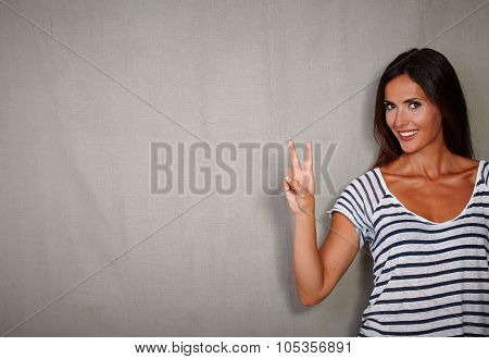 Good-looking Woman Celebrating With Victory Sign