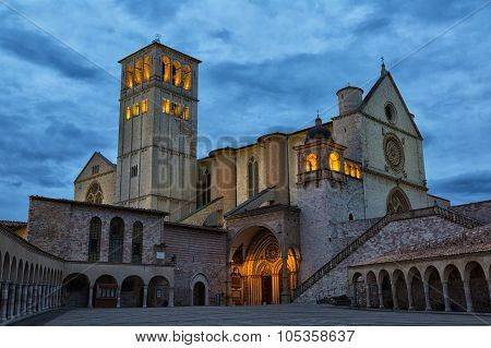 Famous Basilica Of St. Francis Of Assisi (basilica Papale Di San Francesco) With Lower Plazain Night
