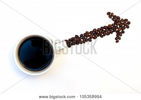Arrow made of coffe beans with cup