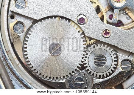 Metal Cogwheels Inside Clockwork. Macro.