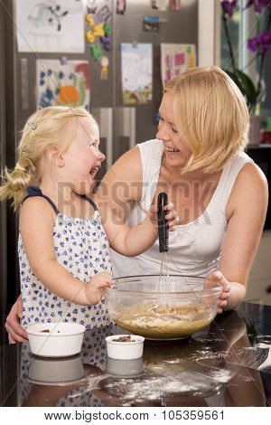 Mother And Toddler Baking