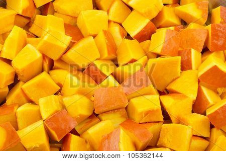 Pumpkin pieces as food background