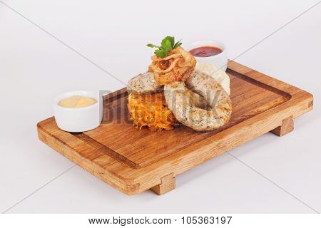 sausages with braised cabbage, wooden board, isolated, white background, fried green onions, parsley
