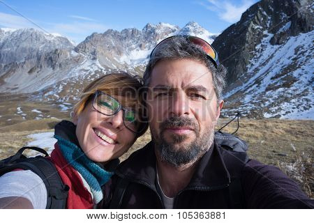 Couple Of Hikers Taking Selfie In The Alps