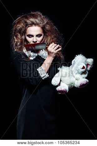 Horror Shot: Scary Monster Girl With Torn Rabbit Toy And Bloody Knife In Hands
