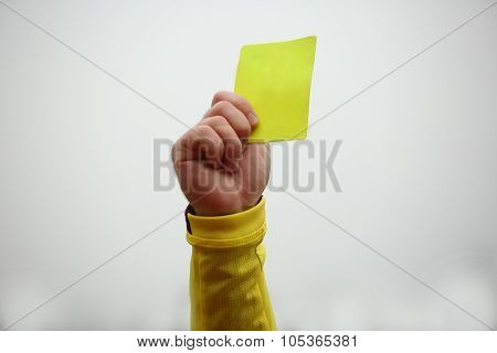 Hand  Holding Up Yellow Card