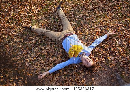 Happy Hipster Lying In Autumn Park
