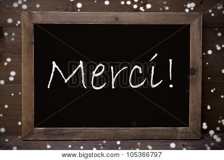 Chalkboard With Merci Means Thank You, Snowflakes