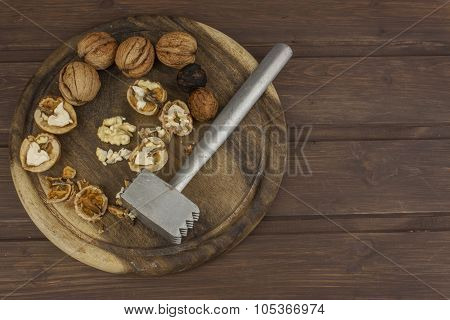 Peeling fresh walnuts, walnut dessert preparation. Walnuts on the kitchen table.