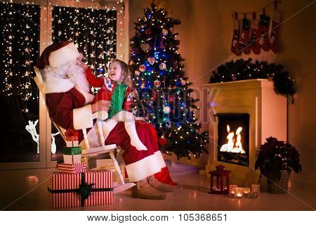 Santa And Little Girl Under Christmas Tree