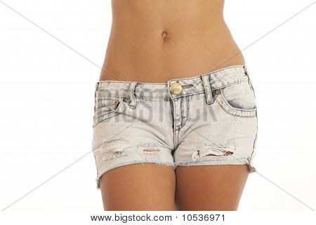 Waist and hips of young sexy woman wearing jean shorts