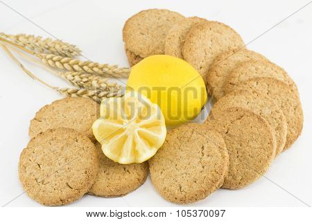 Integral Cookies And Decorated Lemon On White Background