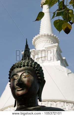 Buddha Statue With Stupa And Bo Leaves