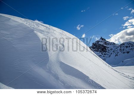 Piste slope at sun day.