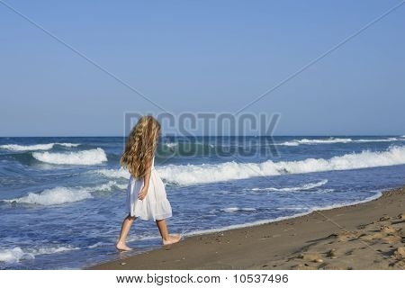 Little Girl Running Beach In Blue Sea