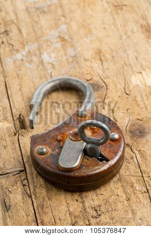 Open Antique Padlock With Key In Lock
