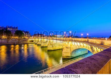 Paris bridge and Seine river at night.
