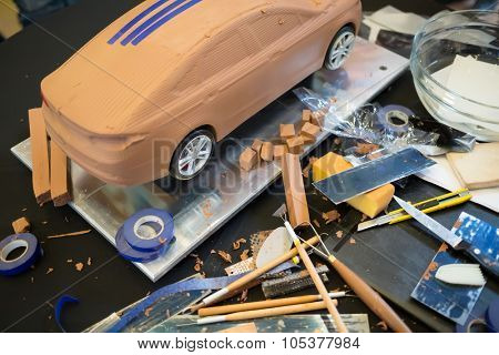 RUSSIA, MOSCOW -?? 4 DEC, 2014: Tools for modeling and miniature car made of clay at the press event for Ford in SREDA loft.