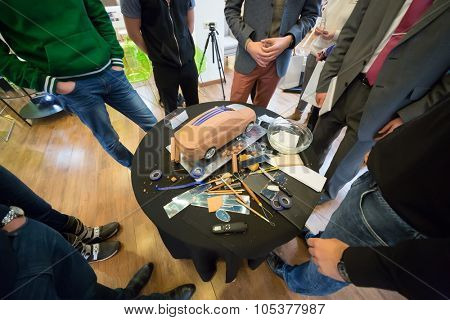 RUSSIA, MOSCOW -?? 4 DEC, 2014: People stand around a small round table with a clay model of a car at the press event for Ford in SREDA loft.