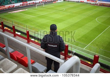 RUSSIA, MOSCOW - NOV 02, 2014: Policeman is standing at grandstand on Locomotive football stadium.