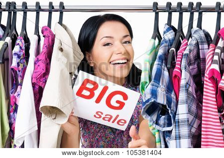 Shopaholic shopping woman with clothes rack, isolated on white background
