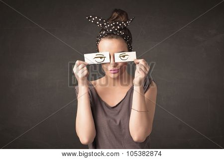 Young person holding paper with angry eye drawing concept