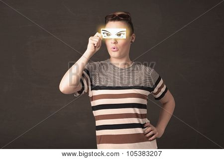Cool youngster looking with a paper hand drawn eyes concept