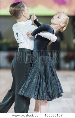 Minsk, Belarus-september 26, 2015:  Romanenko Artem And Shuhurova Kira  Perform Juvenile-1 Standard