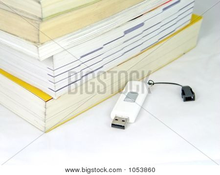 Usb Memory And Book Pile