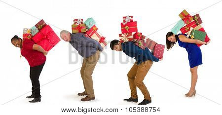 Funny family with too many christmas presents on their back
