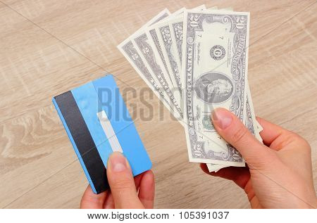 Currencies Dollar And Credit Card In Hand, Finance Concept