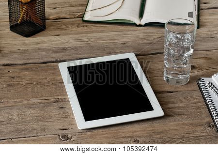 Blank White Tablet Computer On Wooden Table Closeup With Notepad