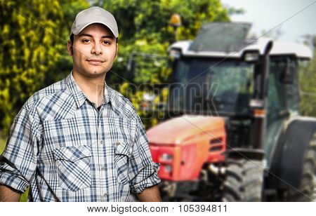 Portrait of a farmer in front of his tractor