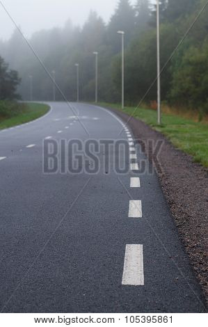 Winding Walkway And Cycle Path On Foggy Morning