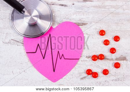 Heart Of Paper With Cardiogram Line, Stethoscope And Supplement Pills, Medicine And Healthcare Conce